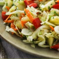 """Cabbage salad on a plate. The words under the image saying """"Healthy Cabbage Salad"""""""