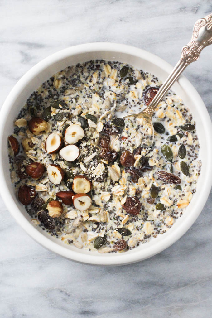 The homemade muesli in a bowl with silver spoon in it.
