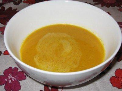 Vegan sweet potato soup in a white bowl.