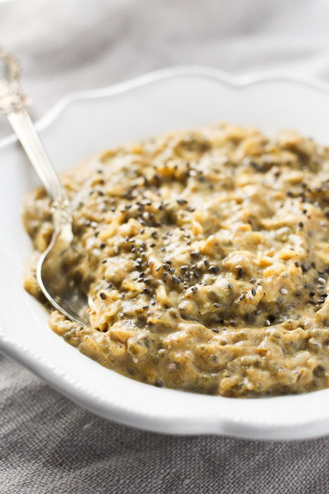 Pumpkin oatmeal on a white plate. Garnished with chia seeds.