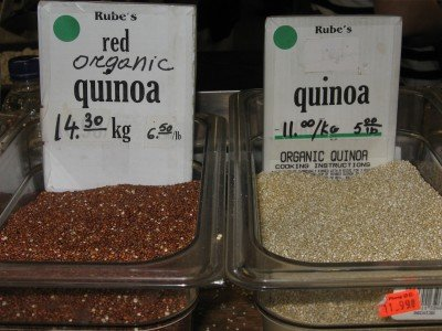 Red and white quinoa in grocery store bins.