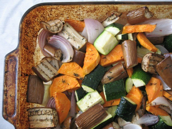 Roasted veggies in a backing dish.
