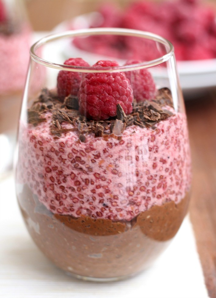 Chocolate and raspberry chia pudding in a glass.