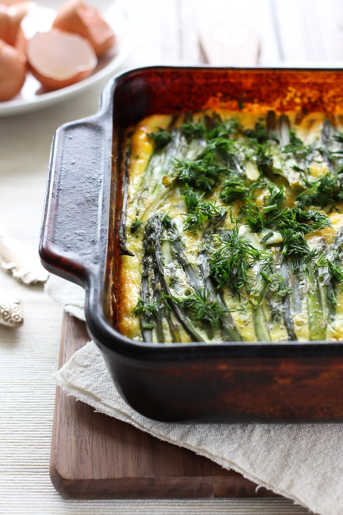 Asparagus and salmon egg bake in a baking dish.