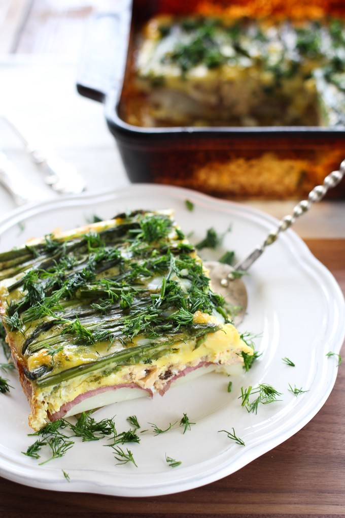 Asparagus and salmon egg bake on a white plate.