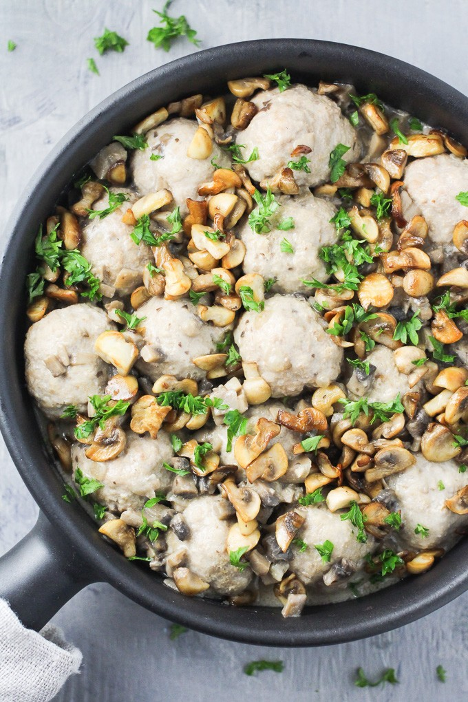 Turkey meatballs with dairy free mushroom sauce in a black skillet.