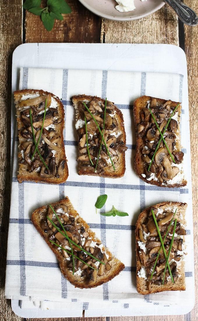 Mushroom crostini on a board.