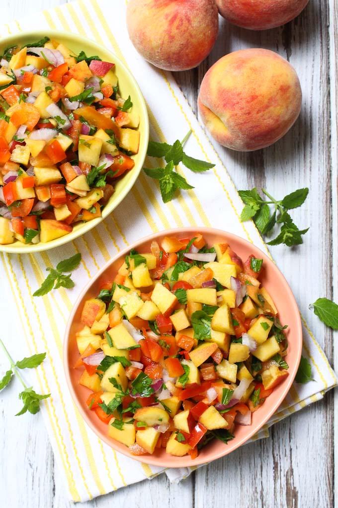 Peach salsa in tow bowls. Top view.