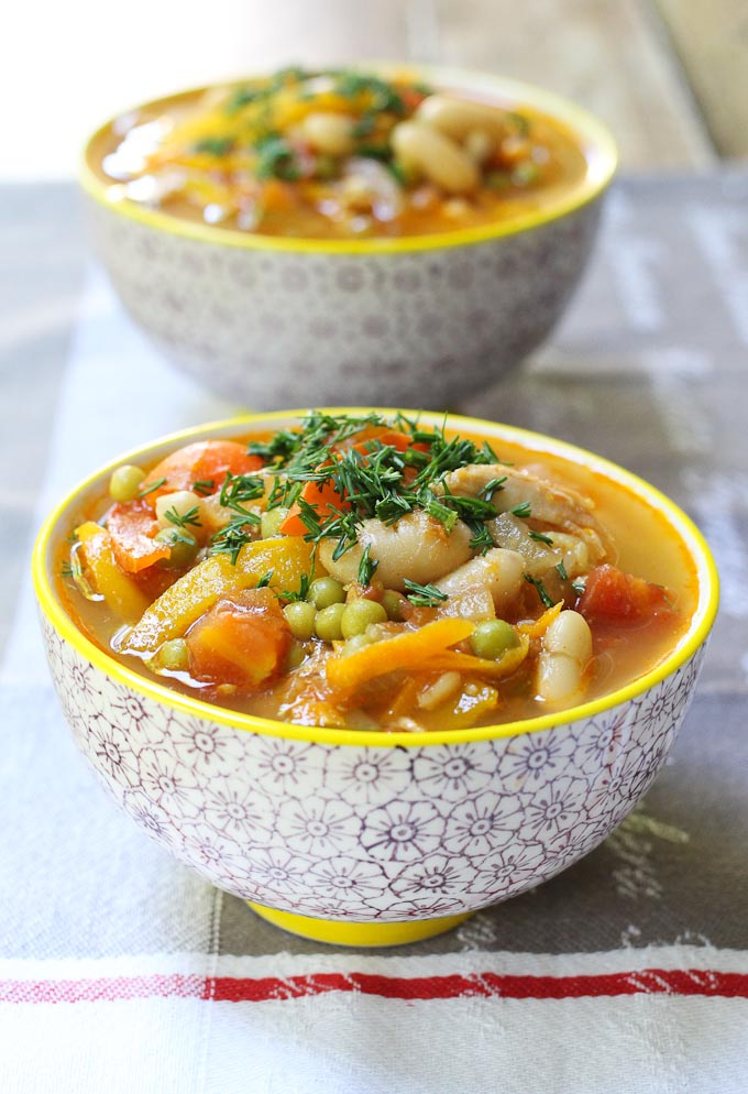 Chicken and white bean soup in bowls.