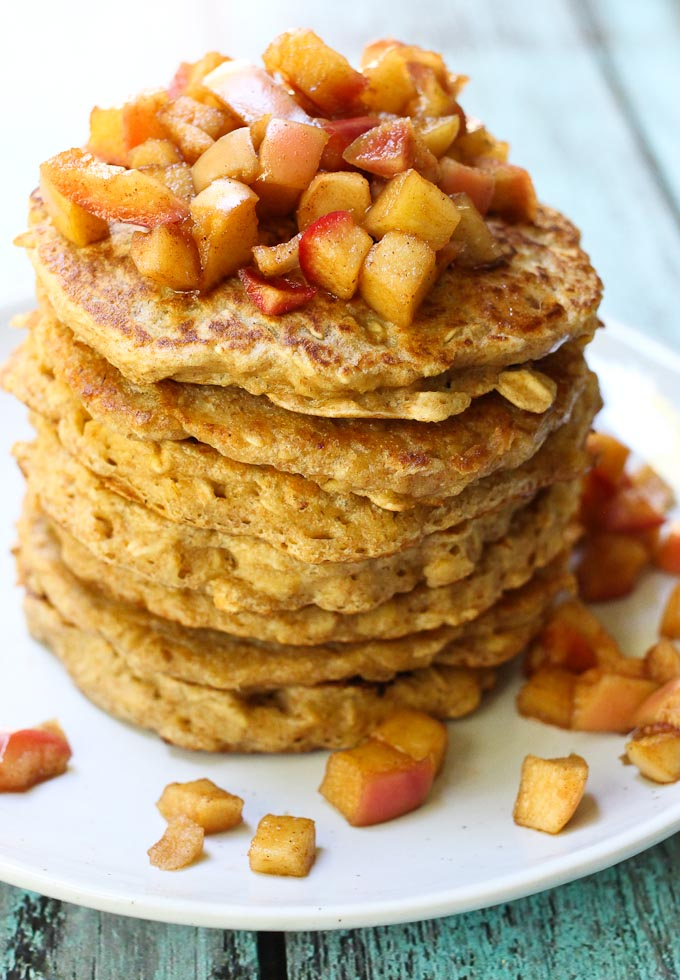 Healthy oatmeal pancakes topped with apple topping.