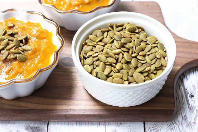 Pumpkin seeds in a ramekin.