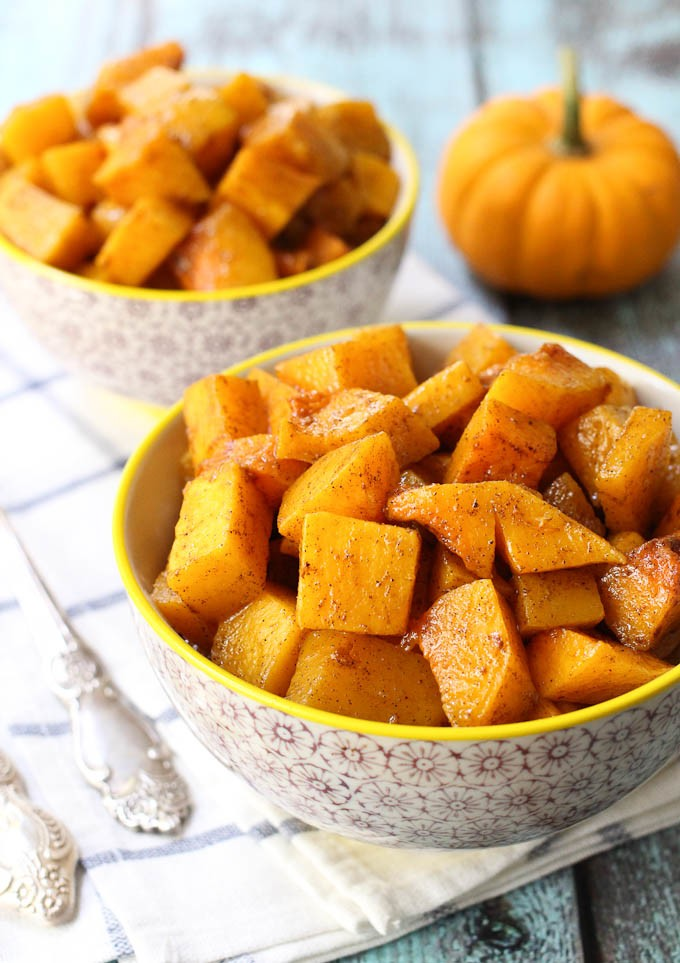 Roasted butternut squash cubes in a bowl.