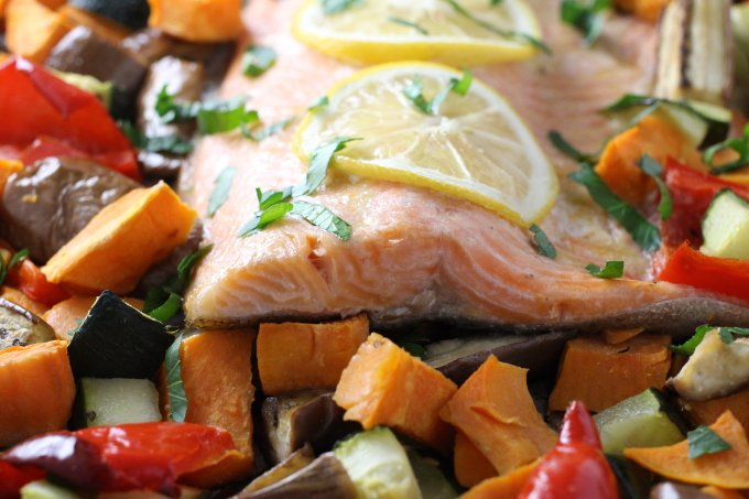 Roasted rainbow trout with chopped vegetables.