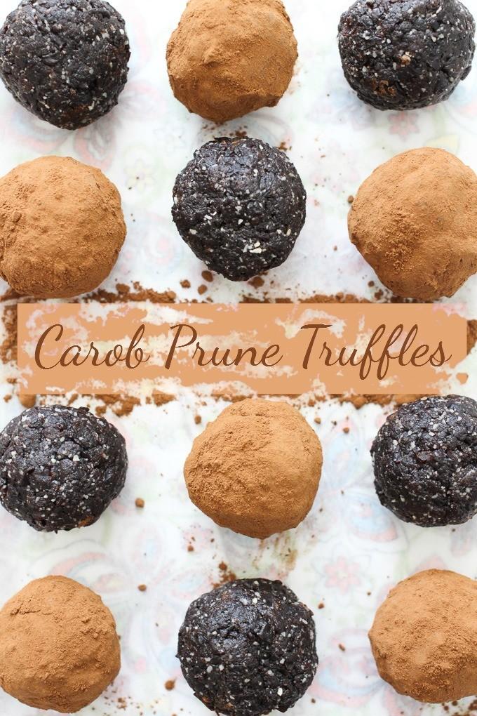 Carob prune truffles on white background.
