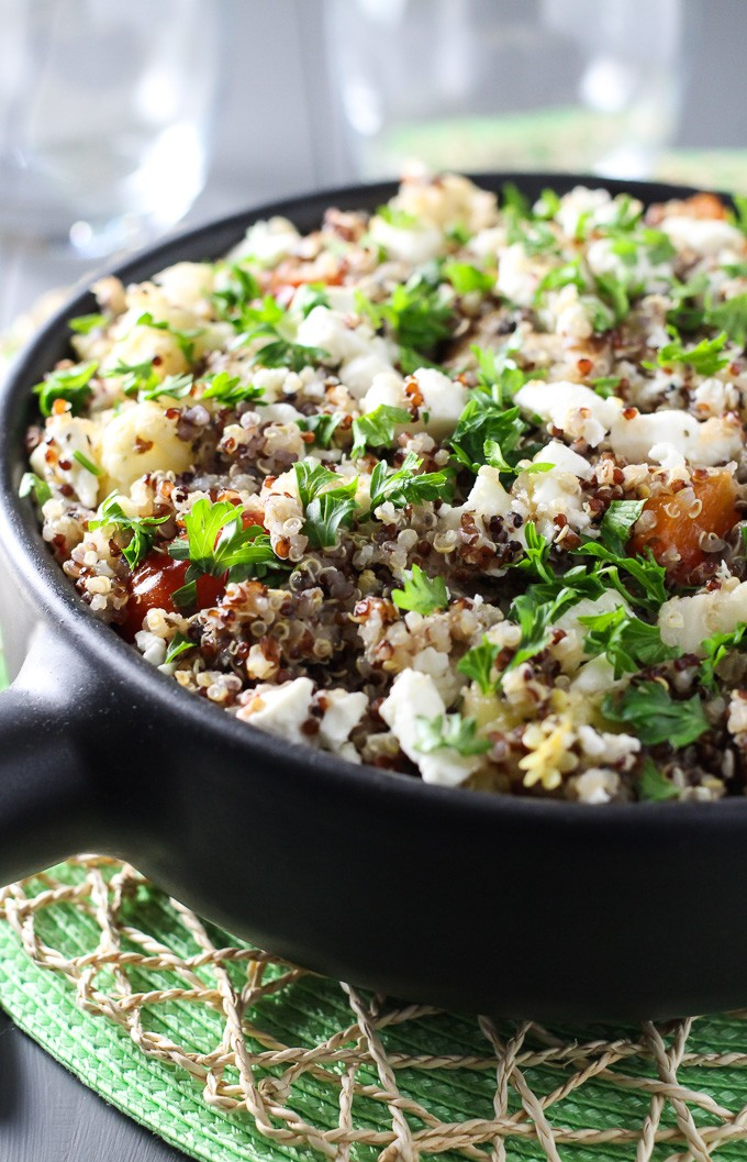 Vegetarian quinoa bake in a black pan.