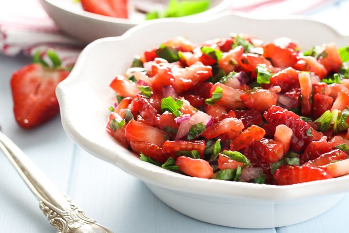 Strawberry salsa on a white plate. Side view.