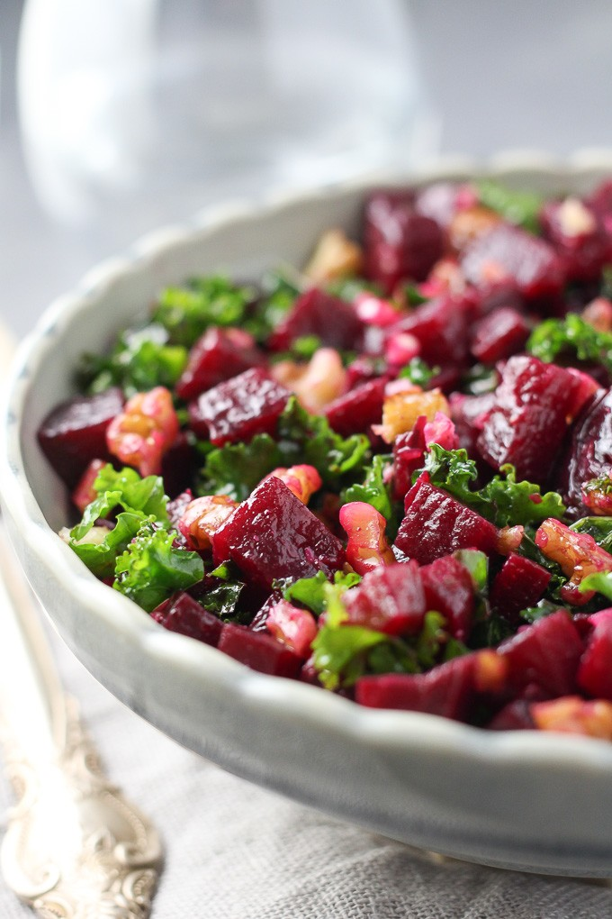 Close-up side view of the detox kale and beet salad in a grey bowl.