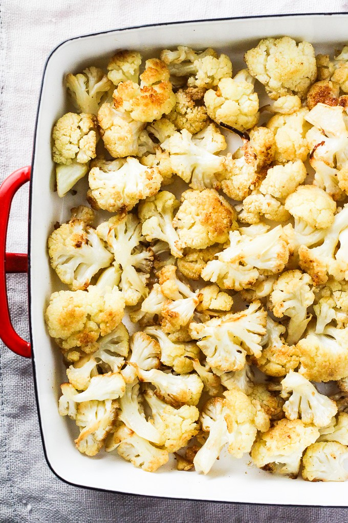 Oven roasted cauliflower in a backing dish. Top view.