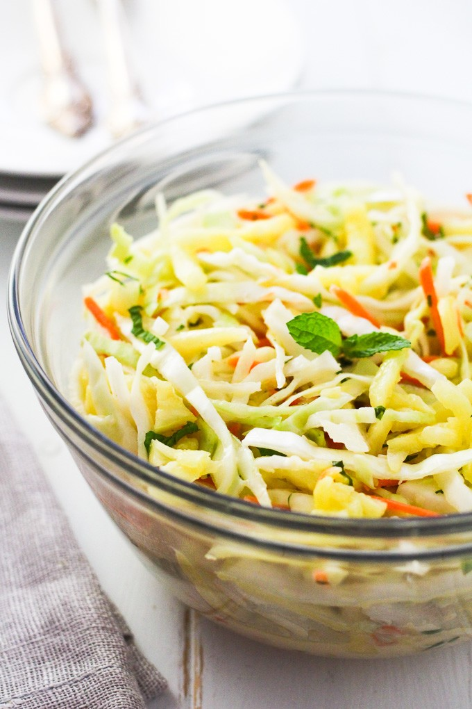 Pineapple coleslaw in a glass bowl.