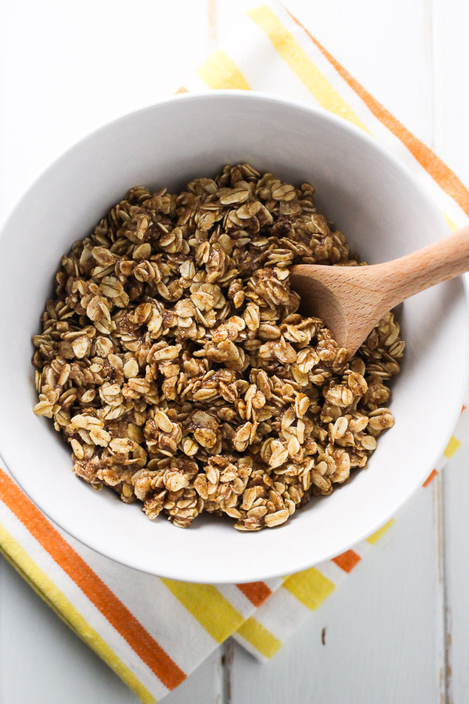 Oat topping in a bowl standing on a kitchen towel.