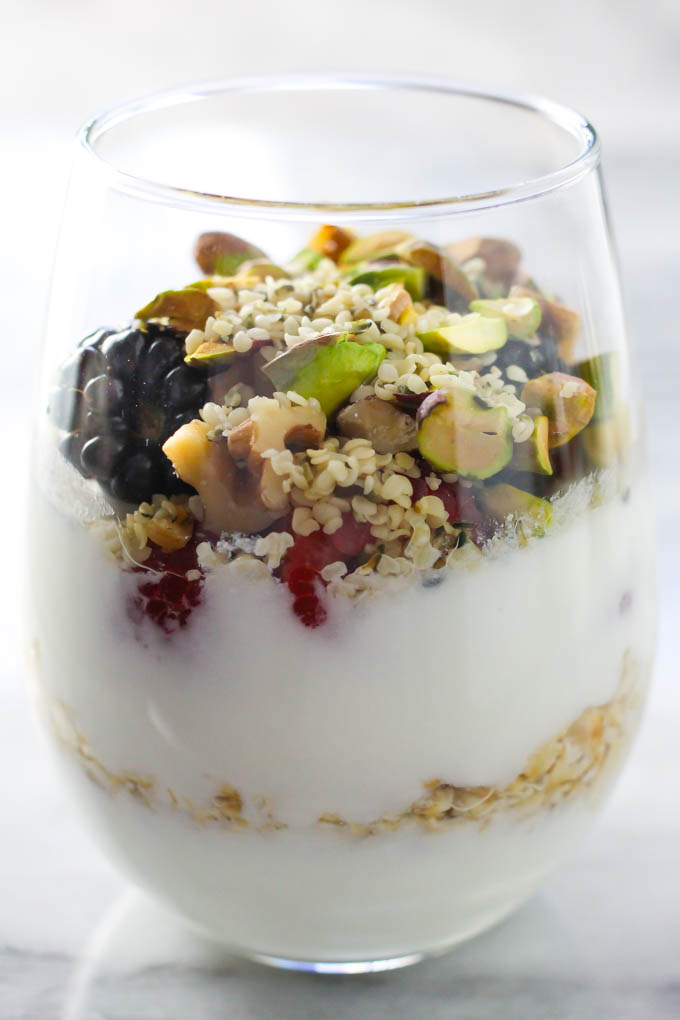 Fruit and nut healthy yogurt parfait in a glass.
