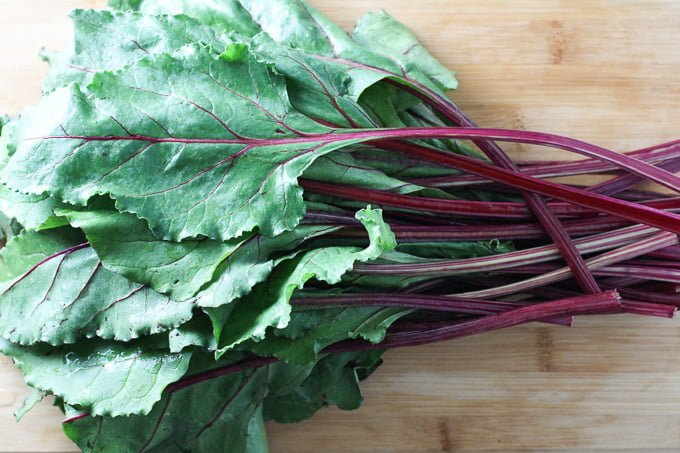 Beet greens on a cutting board.