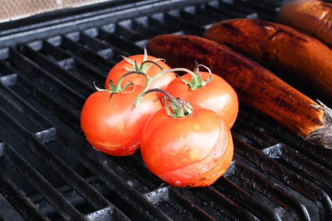 Tomatoes on an outdoor grill.