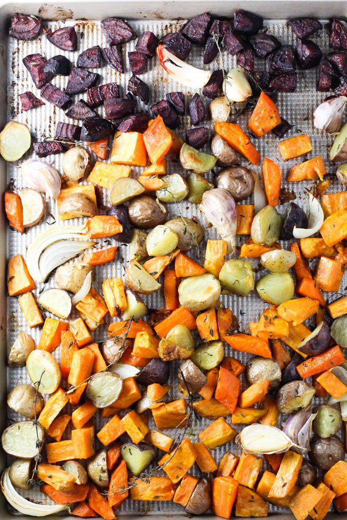 Roasted root vegetables on a baking sheet.