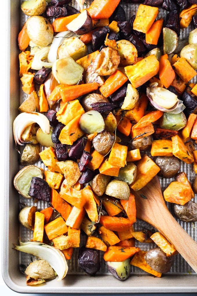 Roasted root vegetables on a sheet pan.