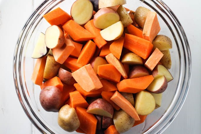 Chopped root vegetables in a glass bowl.