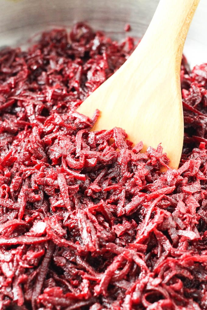 Shredded sauteed beets in a pan.