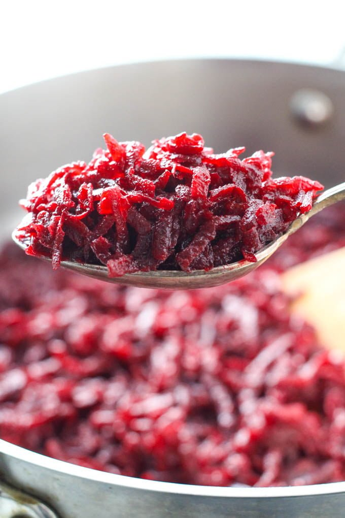 Shredded sauteed beets on a spoon.