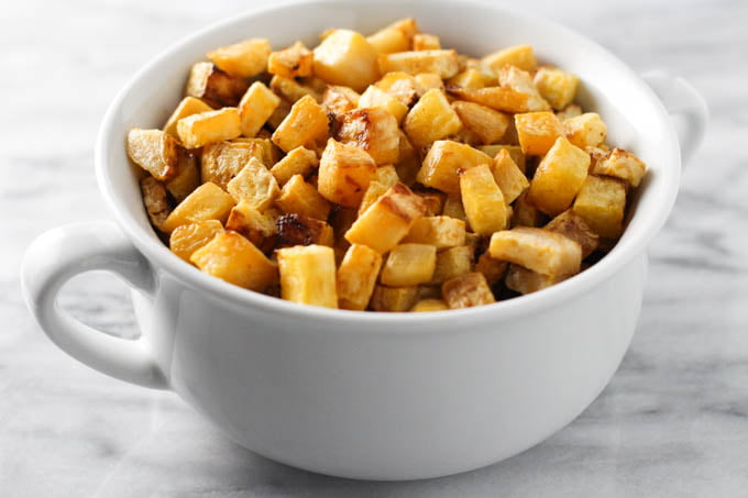 Roasted rutabaga in a white dish.