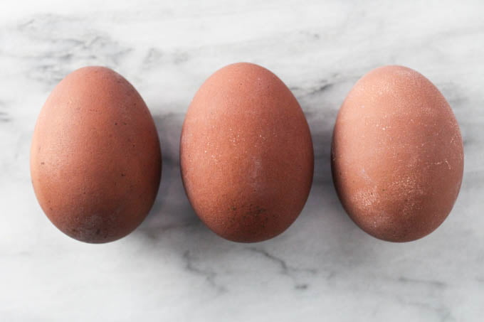Three taupe Easter eggs.