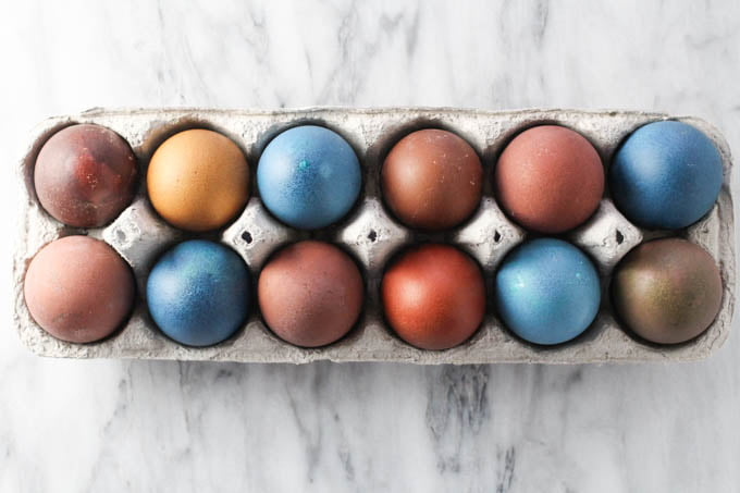 Multicolored Easter eggs in an egg carton.