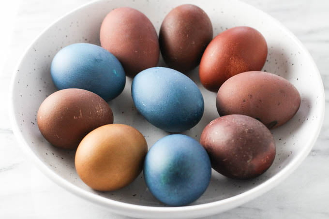 Colored eggs in a bowl.