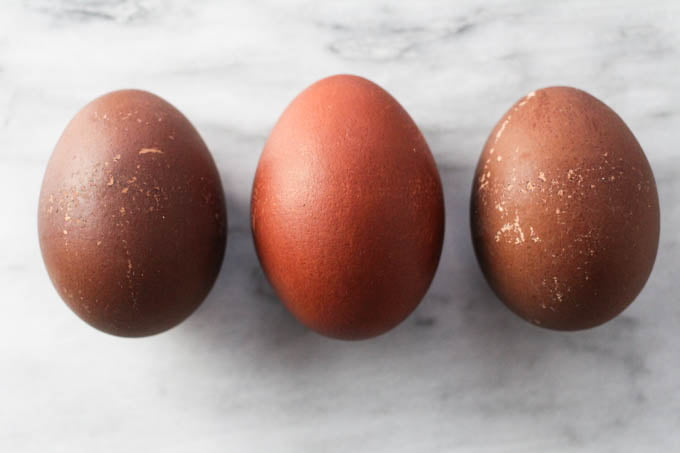 Three red and brown Easter eggs.