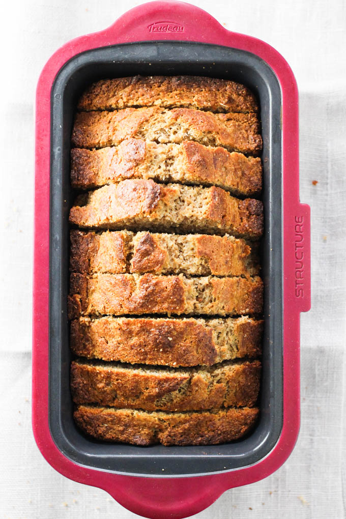 Spelt banana bread slices in a loaf pan. Top view.
