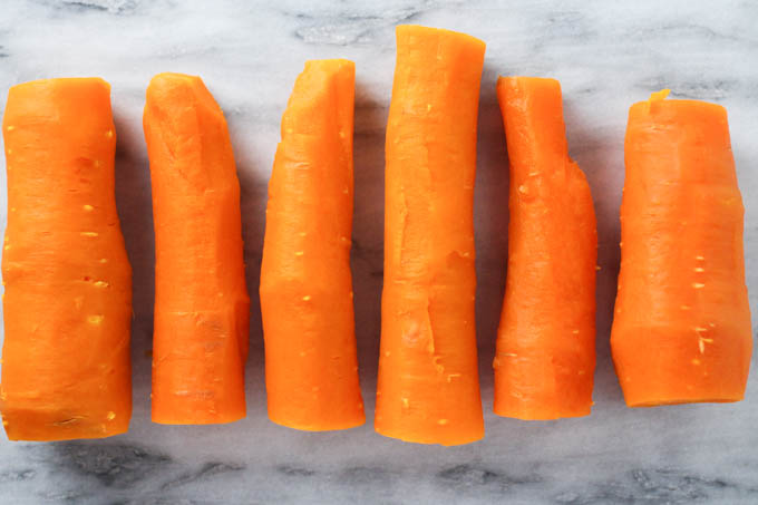 Boiled carrots on a marble background.