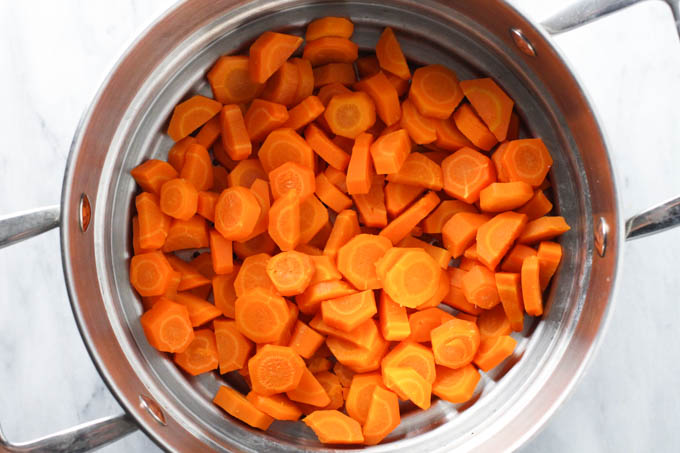 Steamed carrots inside a steam basket.